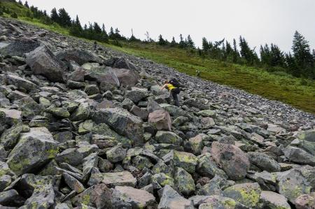Climb up rock scree