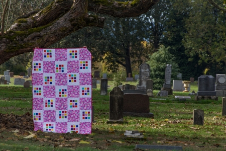 Quilt by tree